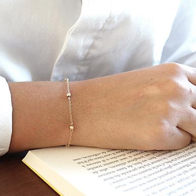 Joobee : bracelet perles dorées Alex de Sissi 100Fils porté